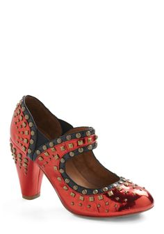 Transport yourself to a world of fantastical fashion with these Jeffrey Campbell Mary Janes! Whether you're scoping out art shows along the brick streets of the city or off to get pampered at an upscale salon, the patent red upper, black trim, and brass studs of these storied shoes will add a smile to your style.