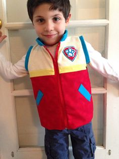 Your little Paw Patrol fan will love this Ryder inspired vest.  Vest is made of Flannel stripes and fully lined in red cotton. Striped panels in