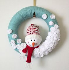This adorable snowman wreath was for sale (but is now sold out) but it doesn't look too difficult to make. I love the softer blue with the red. It would be cute with white snowflakes (maybe crocheted or bought) on it too instead of the white balls. Great inspiration piece.