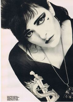 Siouxsie.  Is she vintage yet? Cause I loooove her..
