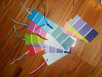 bookmarks made form paint strips and ribbon - kids can stamp on strip to make it unique