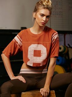 Half Time Tee | A classic style gets a modern update with this effortless cropped tee. Featuring mesh back panel and three-quarter sleeves. Crew neckline and slouchy silhouette.
