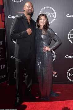 Getting close: Hope Solo and Jerramy Stevens arrive at The Microsoft Centre in LA...