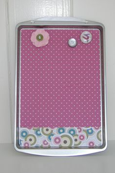 MOPS Craft for 2011-2012. Magnet board. Decoupage scrapbook papers onto a cookie sheet. Make magnets with buttons, flat backed glass marbles and paper punches.
