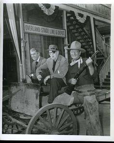 "James Stewart, John Ford, and John Wayne on the set of ""The Man Who Shot Liberty Valance."""
