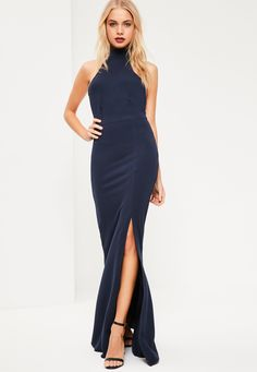 We've got a total girl crush situation over this navy maxi dress - featuring a choker neck, split hem and low back.