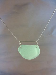 Natural Sea Foam Green Sea Glass Pendant #sea glass beads & #sea charms: http://www.ecrafty.com/c-780-sea-glass-beads.aspx?pagenum=1===newarrivals=60