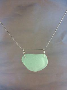 Natural Sea Foam Green Sea Glass Pendant #sea glass beads & #sea charms: http://www.ecrafty.com/c-780-sea-glass-beads.aspx?pagenum=1===newarrivals=60