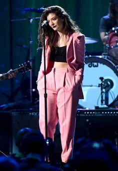 Lorde wearing a pink Vionnet suit at the induction of Nirvana's late singer Kurt Cobain to the Rock Hall of Fame.