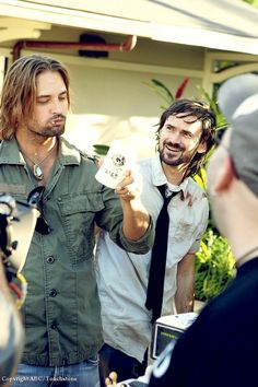 To celebrate the 100th episode of LOST, they had a huge cake. Part of it was in the shape of a Dharma beer can, and Josh Holloway took a big bite out of it, seen here with Jeremy Davies.