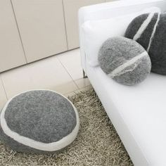 Comfortable Living Room with White Padded Sofa Completed with sTONE Pillows and Cushion in Different Size - Simple Grey sTONE Pillows Displayed on White Sofa Designed with White Lining on the Surface to Match the Sofa