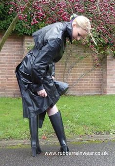 This beautiful babe is ready to go in her revealing Rubber Rainwear! Find more on our website!
