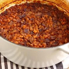 This recipe for Boston baked beans uses navy beans, molasses, brown sugar, and ketchup to create a wonderful old-fashioned baked bean flavor. Homemade Baked Beans, Baked Bean Recipes, Beans Recipes, Navy Bean Recipes, Chef John Recipes, Cooking Recipes, Oven Recipes, Traeger Recipes, Recipes