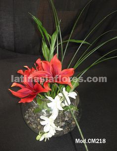 #orange lilies and #white dendrobium orchid centerpiece