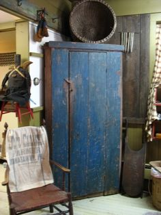 Blue Primitive Cupboard.