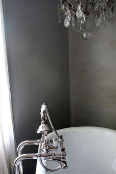 silver bathroom walls + chandelier