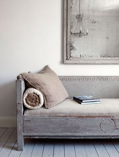 linen upholstered distressed grey bench with neck roll pillow