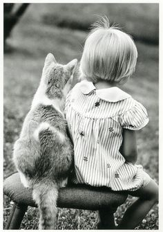 Girl and a Cat; by IchabodH, on Flickr.com.