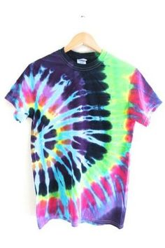 Black, light blue, green, yellow, purple and pink rainbow tie-dyed 100% cotton t-shirt. Please note: Each tie-dyed tee is hand dyed and slightly unique. Washing instructions: Machine wash inside out in very cold water, dry normally...