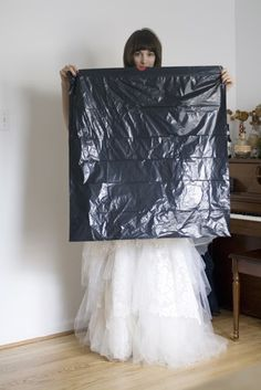 How to use a trash bag to hold your wedding dress while you pee! Genius!