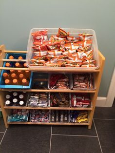 I repurposed our old toy bin rack to use as a snack center for the kids. It fits four standard size plastic shoe bins across and provides easy access.