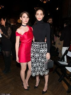 The more the merrier! Brie posed up with Emmy Rossum, who carried a box clutch and a wore a print skirt