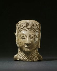 Ivory head of a woman. Assyrian, c. 900 - 700 B.C.   The British Museum