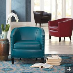 Giles Club Chair. Leather. Deep Teal. Deep Red. Dark Brown. Sophisticated