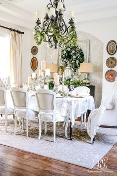 Christmas dining room. Elegant white and gold with evergreens