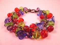 Flower Charm Bracelet Purple Green and Red Summer by justCHARMING, $28.00 https://www.etsy.com/listing/66222325/flower-charm-bracelet-purple-green-and