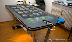 """Oh yea. It's real but not for sale yet. Connect your iPhone and you go from 3"""" to a functioning  58""""!  http://blog.appboy.com/2010/11/massive-iphone-table-in-the-works/"""