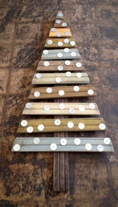 Christmas Tree made out of pallet reclaimed wood and metal. By Jim Lakey of The Art Of Recycling