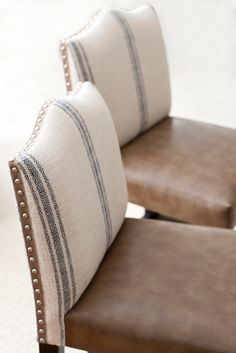 French striped chairs with nailhead trim. Muse Interiors