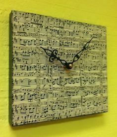 Ermagersh! Decoupaged sheet music! What if I did this on old wine bottles as candle stick holders? hmm...