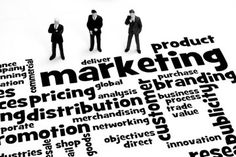 three marketers studying a word cloud with marketing terms