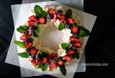 pavlova wreath  inseasontoday.com ... used the Grandma's Pavlova recipe, which has white vinegar and cornflour added to the meringue mixture. The texture is marshmallow-like in the centre and crisp outside. It is less brittle than pavlova recipes without the vinegar and cornflour. .... Personally, I like my wreath festive looking so I used fresh strawberries, fresh mint leaves and frozen mixture of blackberries, raspberries and blueberries to decorate the wreath.