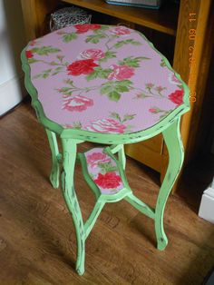 This is a lovely little once dark wood table which I have transformed into a gorgeous green and pink floral table.  I painted it in Annie Sloan chalk paint (Antibes Green mixed with Old White).  I then sanded the paintwork to give it a worn and aged look and finally I waxed it with two coats of clear wax.