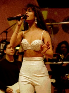 "Selena singing ""No Me Queda Mas"" and her husband Chris playing guitar :)"