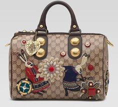 Alice in wonderland gucci themed handbag.