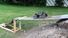 Homemade backyard course sorry cam man was on the phone Outdoor Car Track For Kids, Car Tracks For Kids, Rc Car Track, Backyard Obstacle Course, Rc Rock Crawler, Rc Cars, Picnic Table, Garden Tools, 4x4