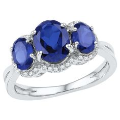 1/10 CT. T.W. Oval Lab Created Sapphire Prong Set Fashion Ring in 10K White Gold - Blue