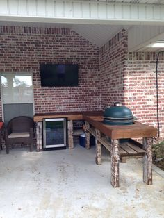 RECYCLED WOOD PALLETS: We built this outdoor kitchen as a special order. He wanted to fit his Big Green Egg in the top. He also wanted the top to be in a double chevron pattern. His 'fridge fits into a cut out in the top of the table and the shelves have backboards to keep things from falling off the back. It is painted and stained. Message us with your needs and we will set a price based on your dimensions. Item #322
