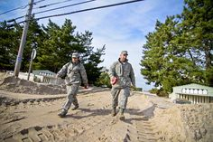 New Jersey National Guard by The National Guard, Airmen and Soldiers from the New Jersey National Guard search house to house for victims of Hurricane Sandy on Long Beach Island, N.J. on Nov 1.