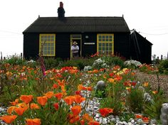 The late Derek Jarman, at the door of his home, Prospect House, on Dungeness