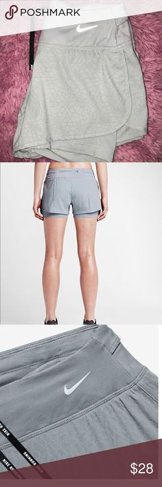 Gray Nike Rival Jacquard Shorts Nike running shorts with Spandex Shorts built in. Thick band around waist. NEVER BEEN WORN. NWOT. No flaws. XS. Bundle to save Nike Shorts