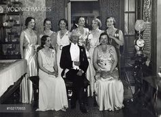 King Gustav V of Sweden surounded by royal ladies on his 75:th birthday at Tullgarn Castle,1933, Sweden. Standing from left: the Prnsesses Margaretha and Sibylla, Crown Princess Astrid, prinsesses Ingeborg and Ingrid, Aitting Cron Princess Louise, King Gustav V and queen Alexandrine of Denmark.