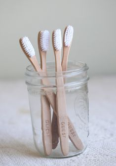 "Cute Idea for guest bathroom!    Be My Guest Sustainable Toothbrush Set 22.99 at shopruche.com. Exercise top notch hospitality and offer your visitor their own toothbrush made from sustainable bamboo labeled with 'Guest' on the arm of the brush. Mason jar not included., ,  Each toothbrush 6.75"" long"