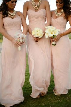 Pearl pink is always a pretty color. It's neutral. And feminine.This particular style is flattering to many figures. You can accent with flowers in colors that you want. But as long as the dresses match, the flowers might as well too. What do you think?