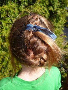 4 sections ear to ear, split each section and tie an overhand knot with the hair, add the next section and tie down to the bottom.   then bring it all together and braid.   weave the braid back and forth into the knots, tie and let the end hand out the side