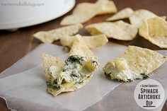 Slow Cooker Spinach Artichoke Dip Recipe Appetizers with frozen spinach, artichoke hearts, cream cheese, shredded mozzarella cheese, grated parmesan cheese, minced garlic, milk, black pepper